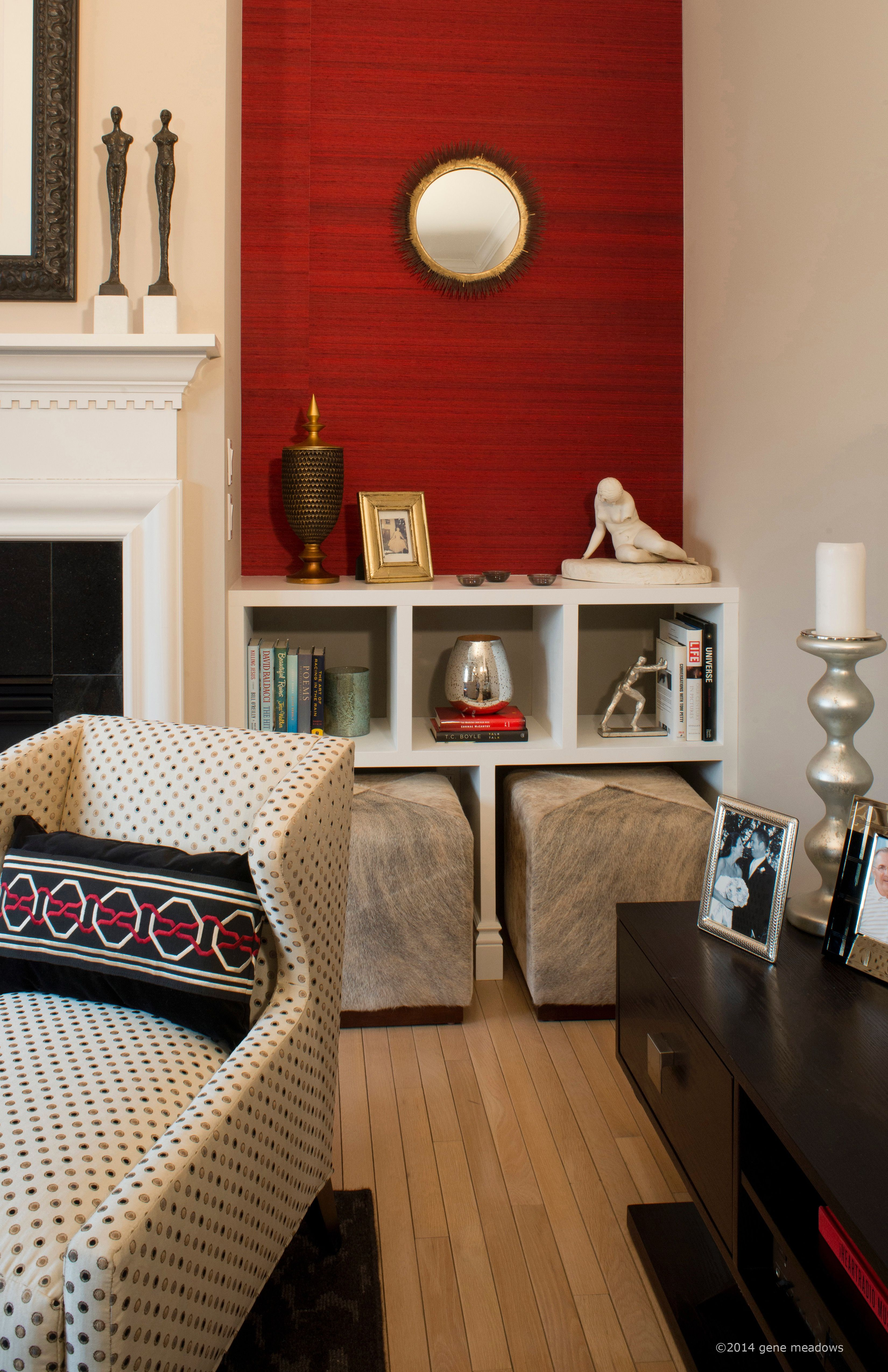 The Interior Design Firm, Dan Davis Design Designed Custom Built In  Bookshelves In This Small Condo, For Display And To House Custom Cowhide  Ottomans For ...