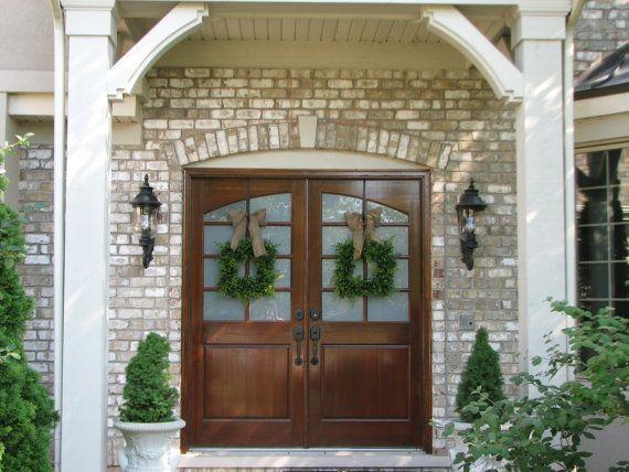 Double doors- double wreaths. Love the simple green. #doubledoorwreaths Double doors- double wreaths. Love the simple green. #doubledoorwreaths