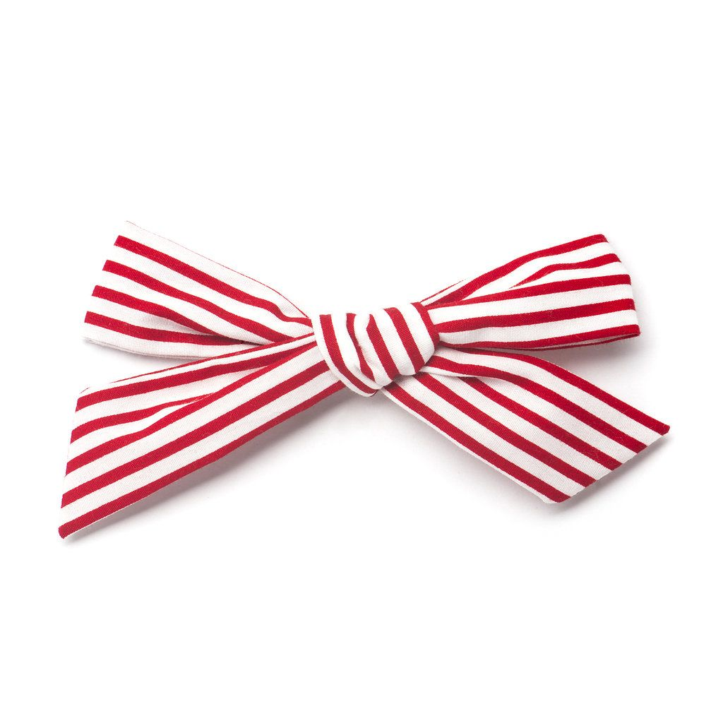 """""""Candy Cane"""" Oversized Schoolgirl bow by Free Babes Handmade. The perfect bow for your little girls holiday style and beyond."""