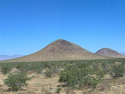 Dome mountain - A mountain formed by pressure from magma beneath - land form