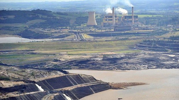 Flooding at the Yallourn power station has hit TRUenergy's earnings. In addition they are cutting back on fossil fuel generation capacity due to the carbon price and falling demand. This is a good outcome for Cimate Change