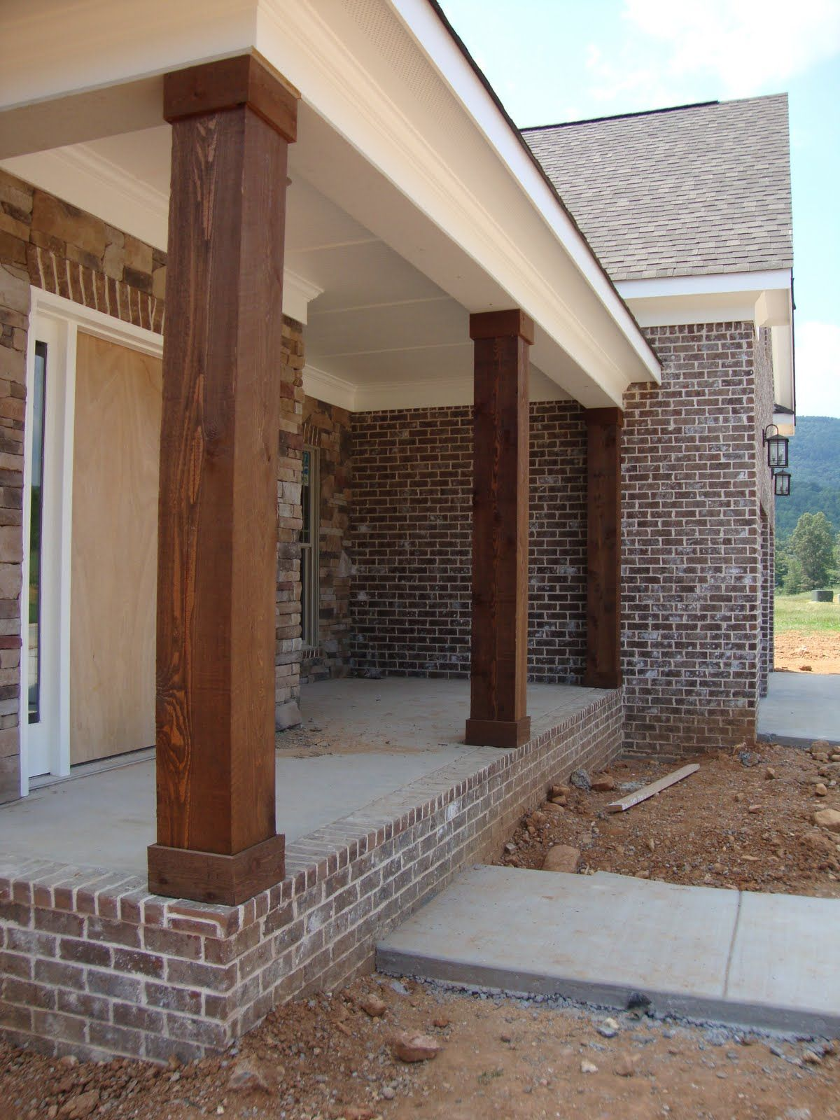 Cedar Columns Lighting And Stained Stairs House Exterior
