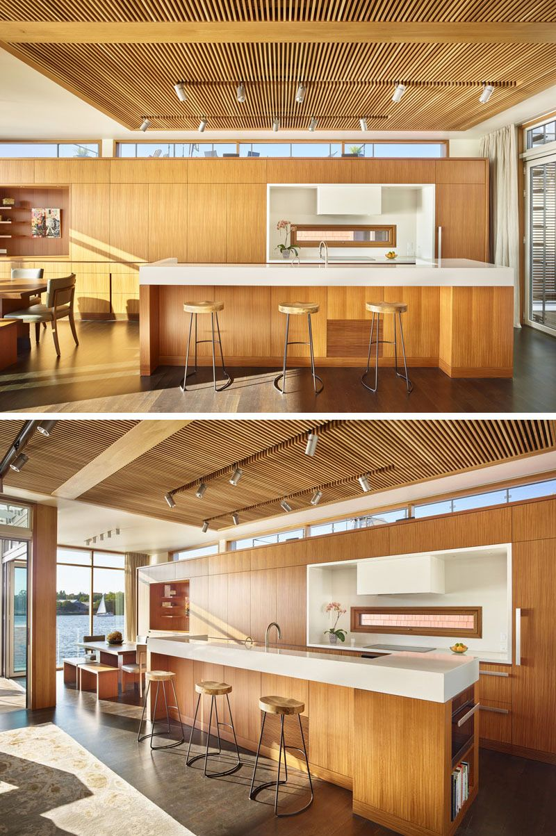 In This Floating Home A Wood Slat Ceiling Feature Anchors The Living Room And Kitchen Provides Contrast To Surrounding White Walls