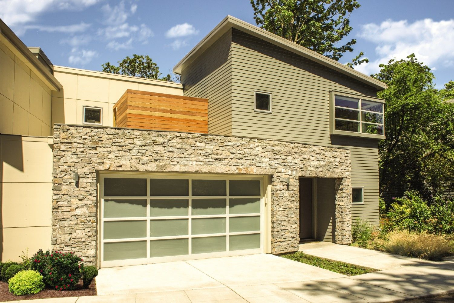 Contemporary home with a modern garage door including beautiful