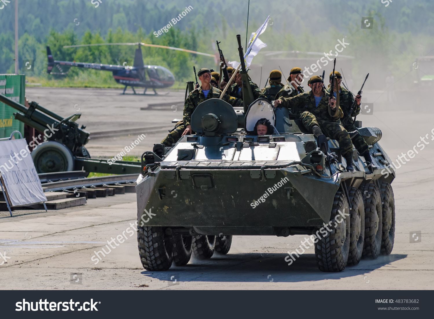 Nizhniy Tagil Russia  July 12 2008 Group of special forces unload from BTR82A armoured personnel carrier on shooting demonstration range