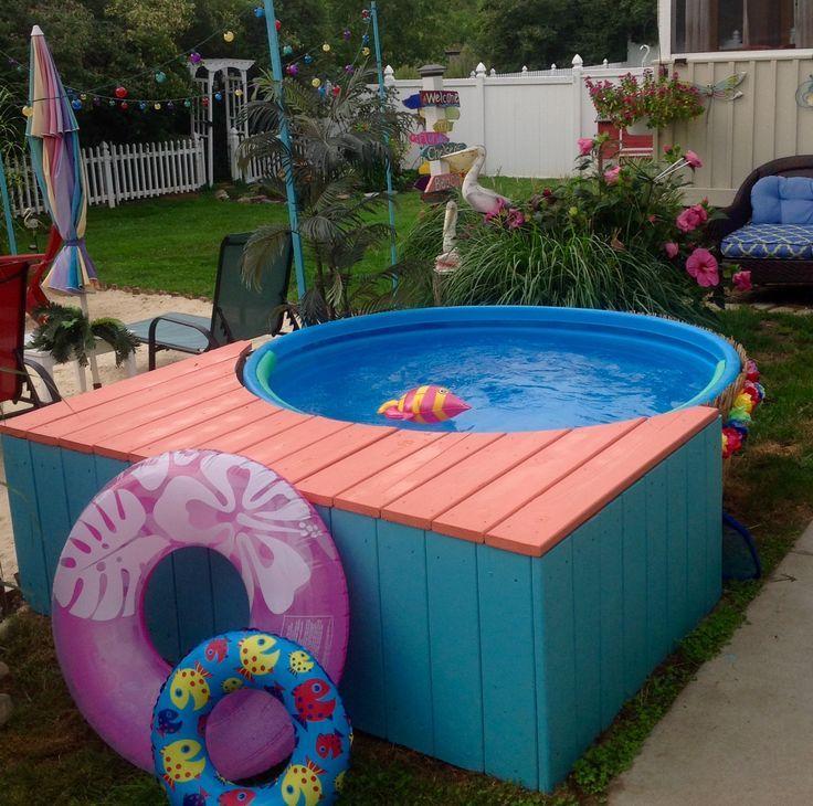 Backyard beach stock tank pool filter is hidden under