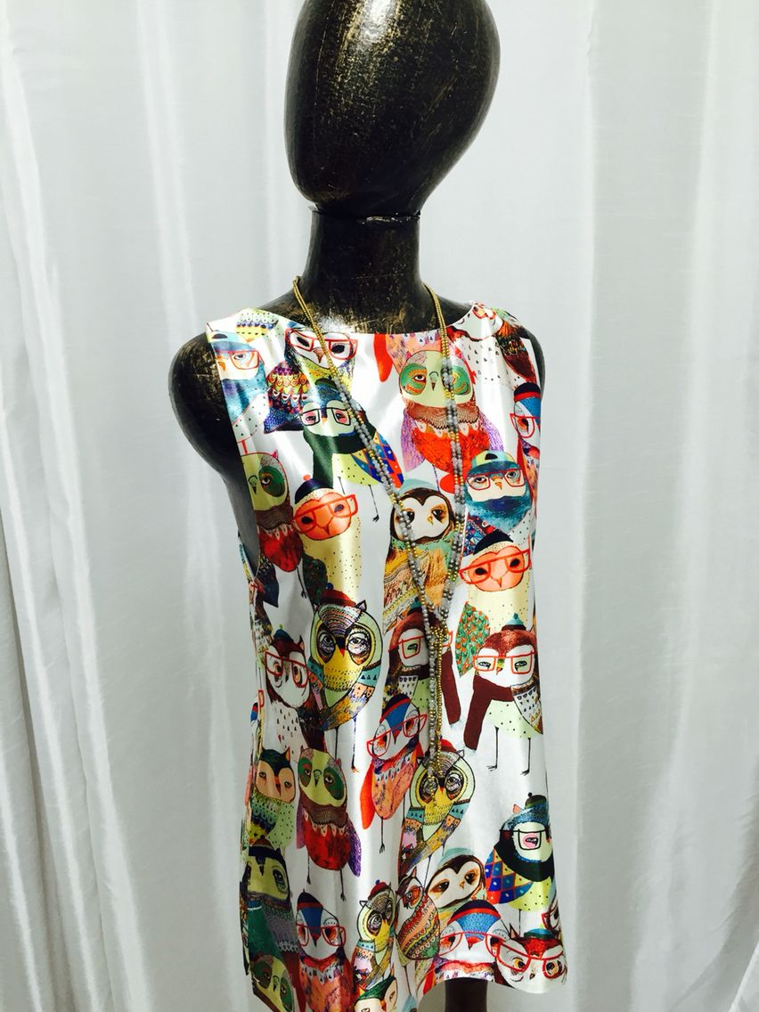 Owls everywhere! Take this colorful shirt on a trip this summer! Silk double lined and crossed straps in the back, with Chinese slits on the sides