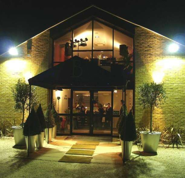 Beautiful Exterior Of Golf Club On A Warm Summers Evening