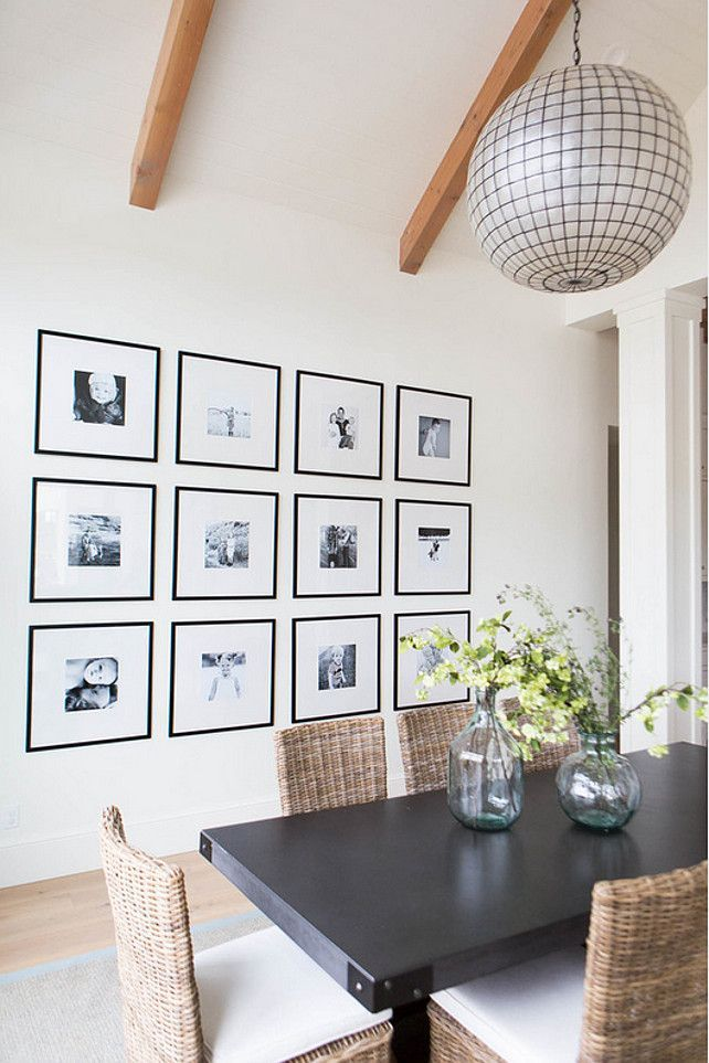 Gallery Wall Of Black And White Family Photos In Frames With Thick Mats
