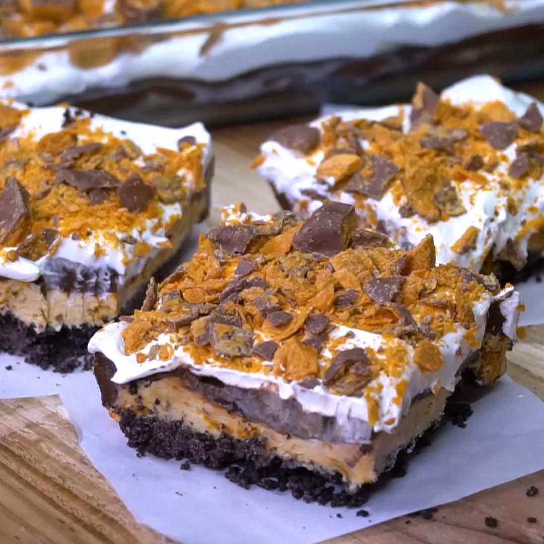 You won't find a more delicious dessert than this cool and creamy Butterfinger Chocolate and Peanut Butter Lush. Layer after layer of heaven! #cheesecakedessertseasy