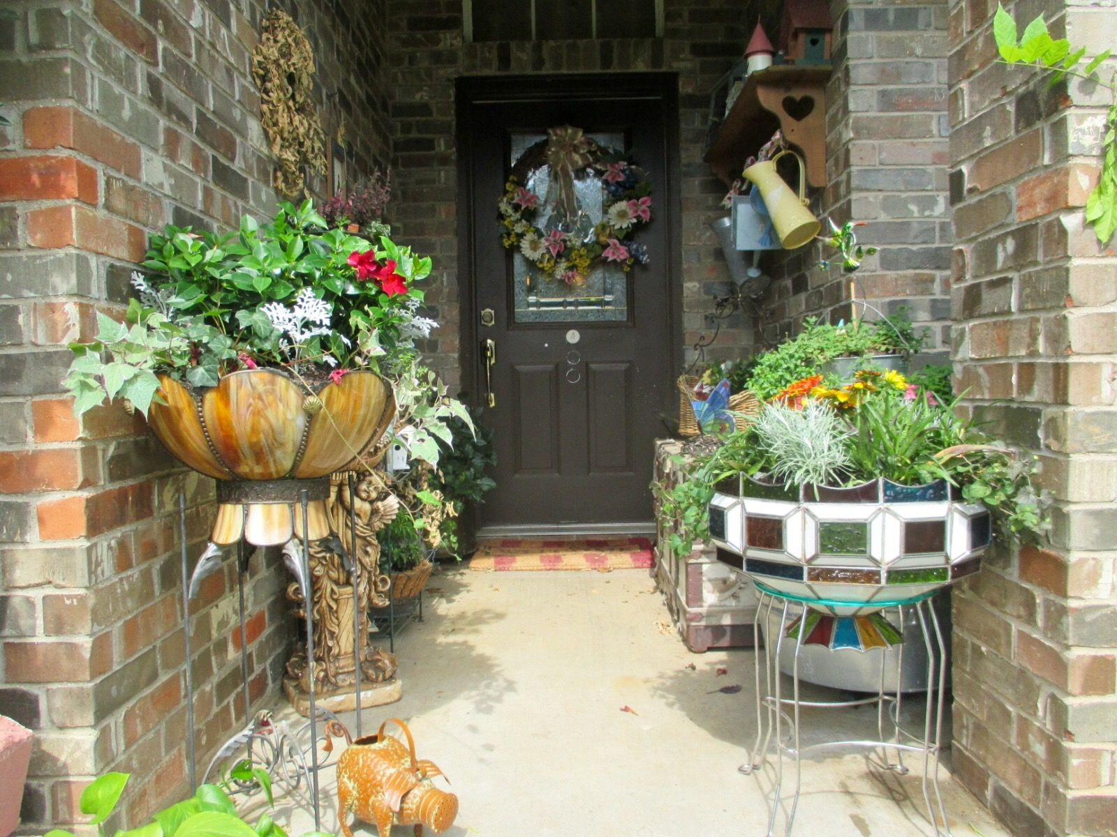 Create a decorative planter from outdated light fixtures