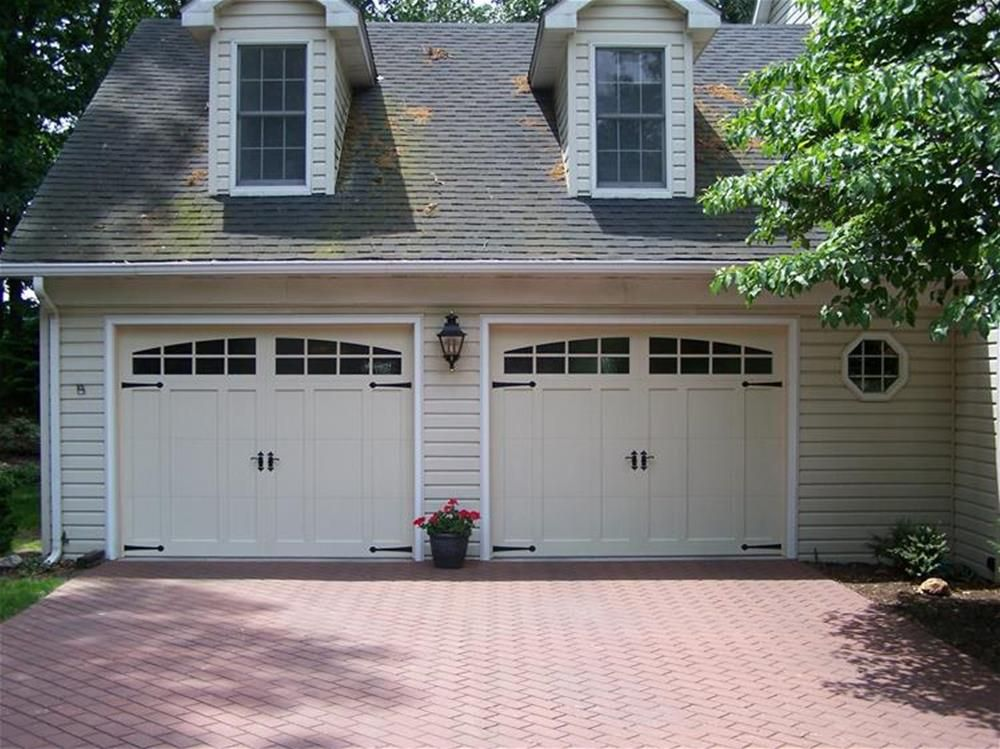 Overhead Doors Model Steel Carriage House Style Garage Doors With Overlay  In Almond With Arch Stockton Glass U0026 Wrought Iron Decorative Hardware