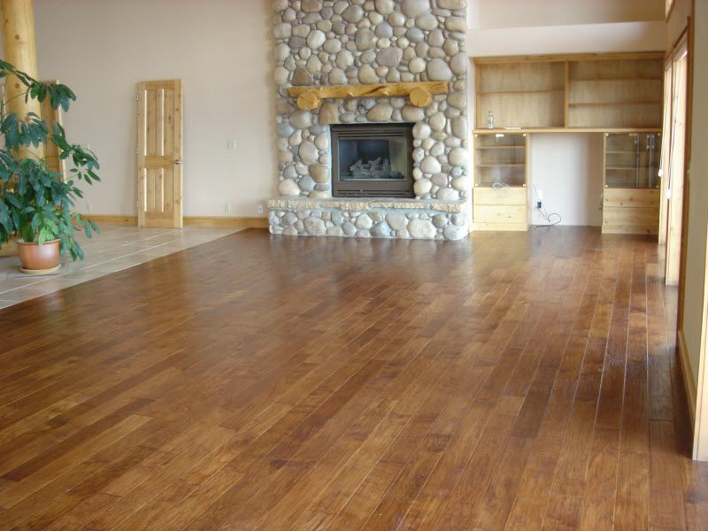 Hand Scraped Floor Stained With A Rich Medium Brown Stain That Accents The Natural Beauty Small Basement Remodel Unfinished Basement Walls Basement Remodeling