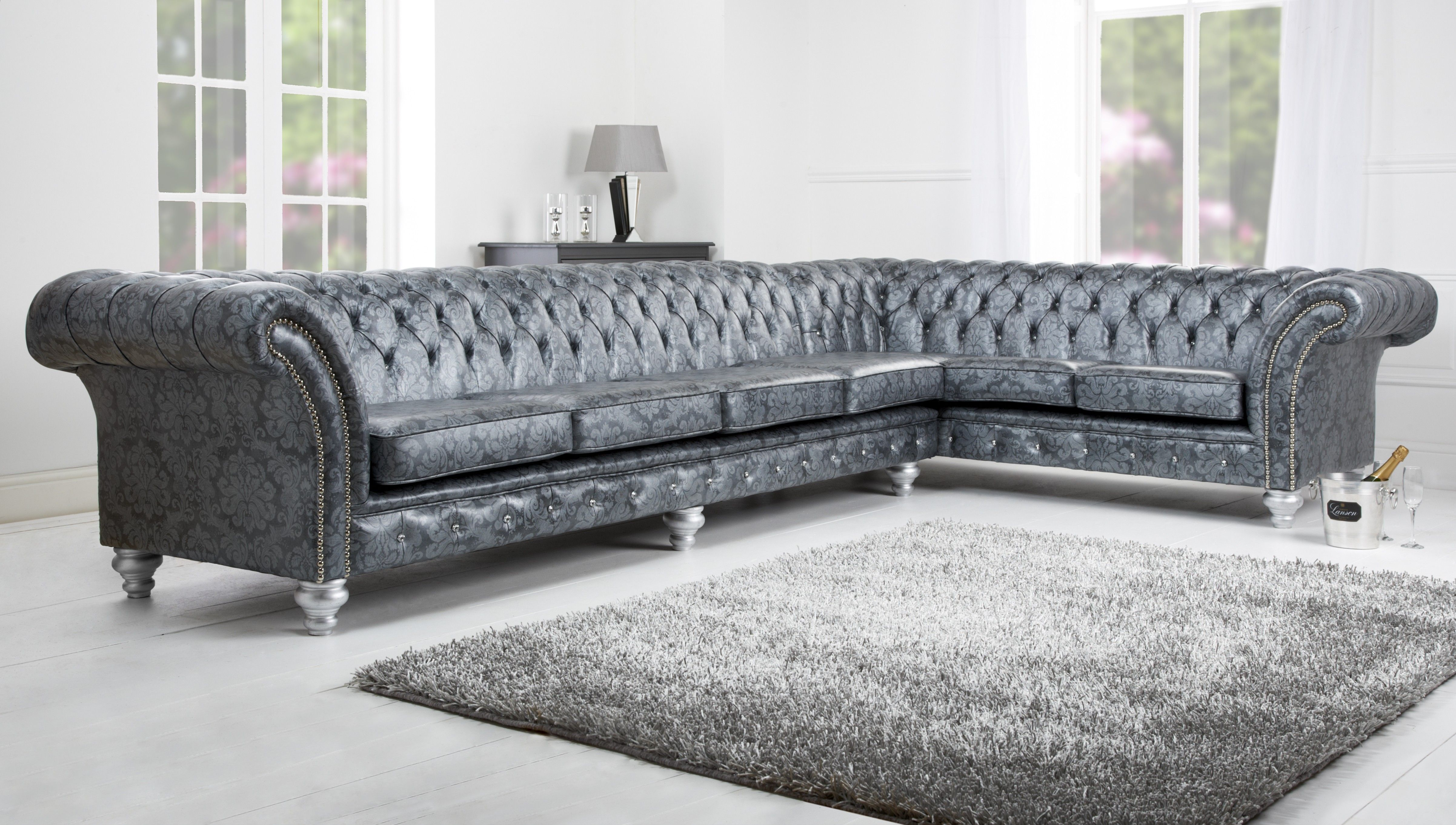 Awesome Cool Grey Tufted L Shaped Sofa Sectional Ideas For Living Room With  Flourish Pattern And High Pleated Arms Plus Leathered Cover And Silver  Finish Wood Bun ...