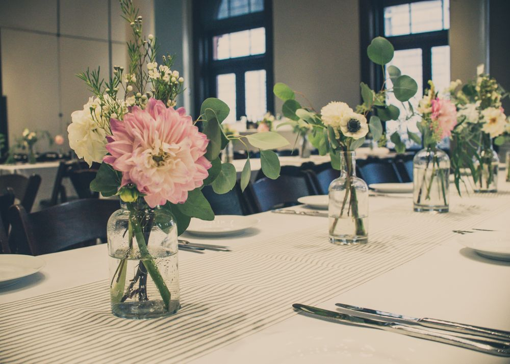 Save Those Whiskey And Wine Bottles To Use For DIY Flower Arrangements In The Great Hall