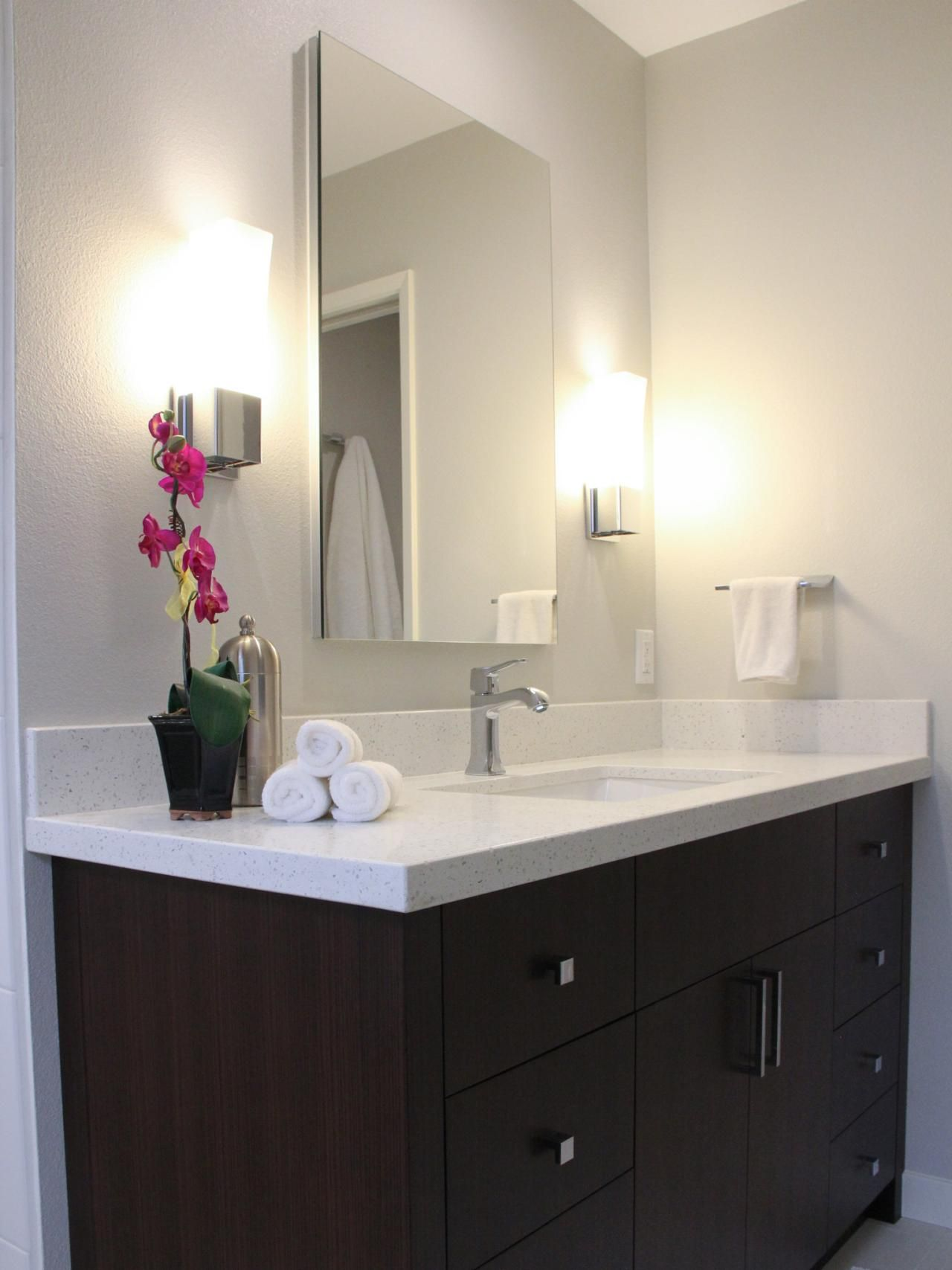 contemporary wall sconces bathroom. A Contemporary Corner Vanity That Offers Mirrored Medicine Cabinet And Wall Sconces To Provide The Bathroom L