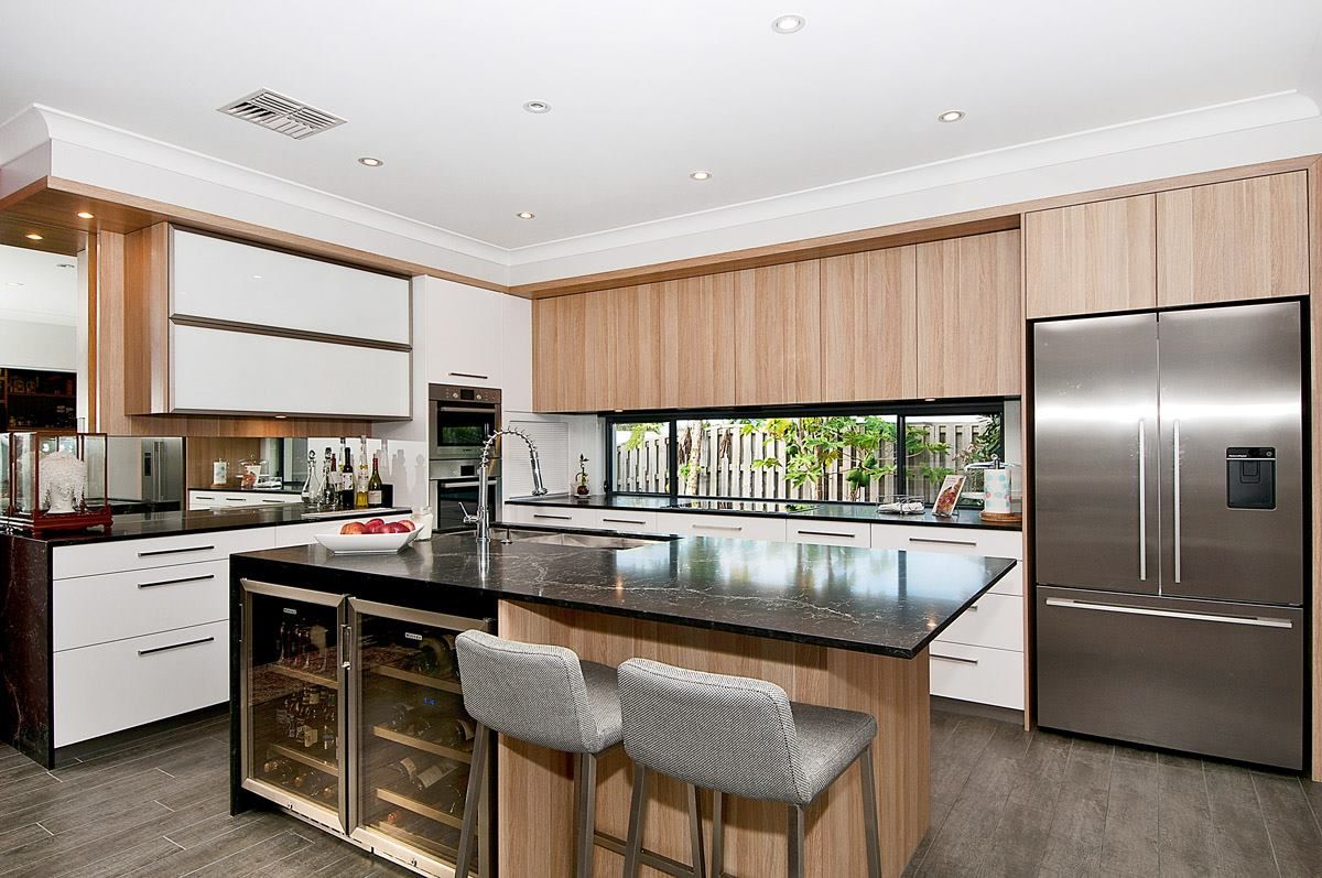 A bold Vanilla Noir kitchen by KitchenTrends to start this