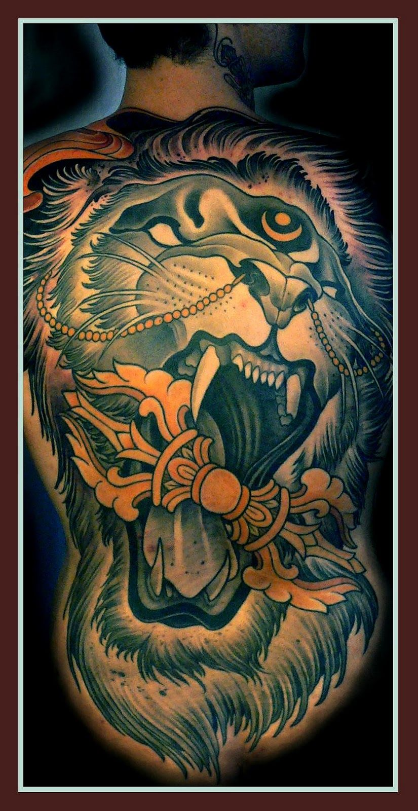 Full back shouting lion tattoo with mouth wide open