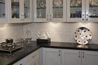 Black granite countertop and white subway tile backsplash also cabinets google search kitchen pinterest