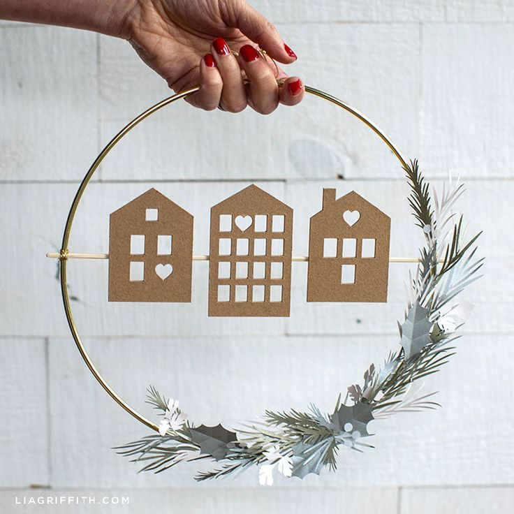 This DIY Scandi house and greenery wreath features three different house designs...