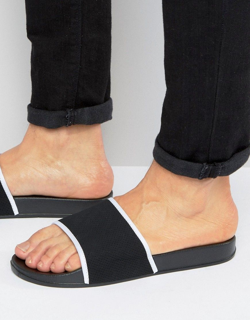 d995a83f12d3a NEW LOOK SLIDERS WITH PERFORATED DETAIL IN BLACK AND WHITE - BLACK.  newlook   shoes
