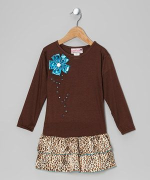 Jazzed with earth tones and a leopard print, this American-made frock is bound to enter high wardrobe rotation. The soft knit bodice gives it a tee-like feel, while the pullover style ensures it's easy for girls to dress themselves.