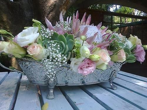 wedding bouquets bridesmaids lisianthus roses pink protea succulents baby s breath 8495
