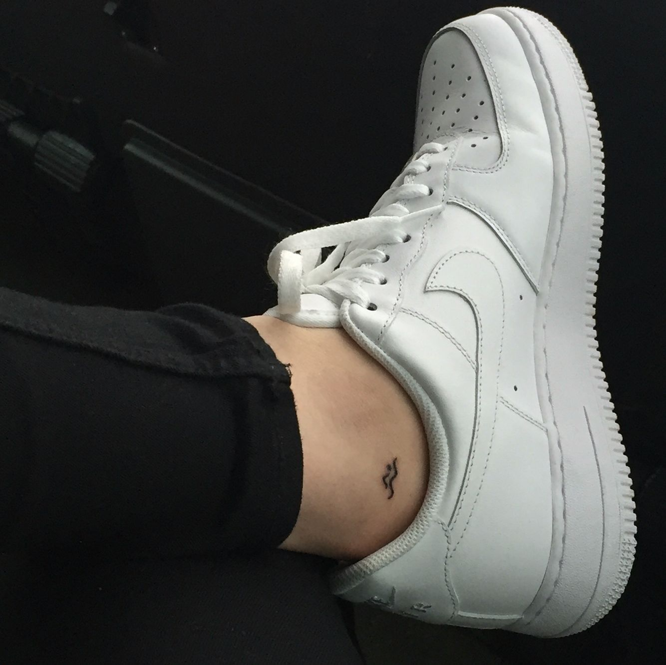 Tiny little tattoo for swimmers. White NIKE Air Force.