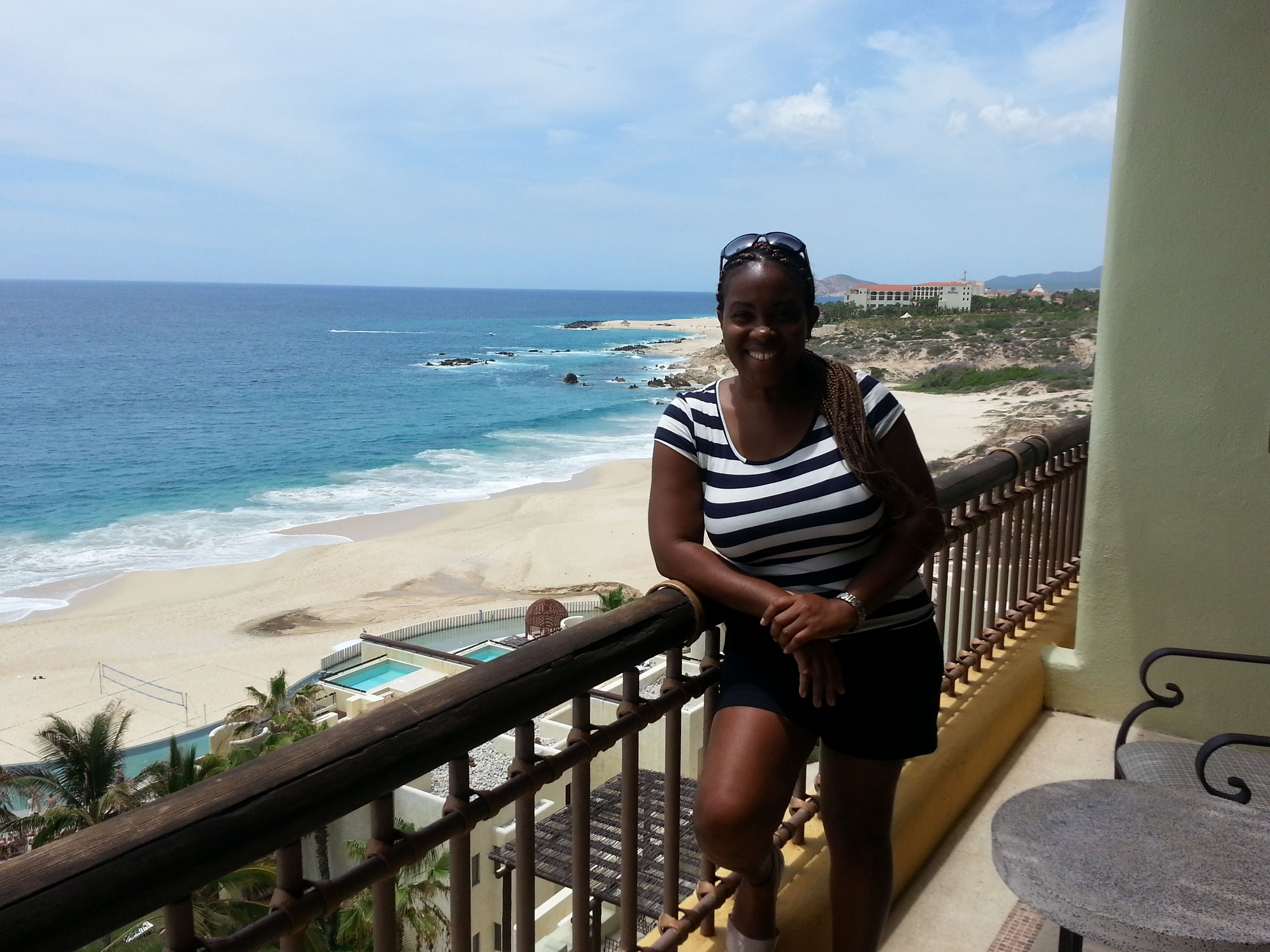 Enjoying the view from the balcony of an oceanfront suite at Secrets Marquis Los Cabos