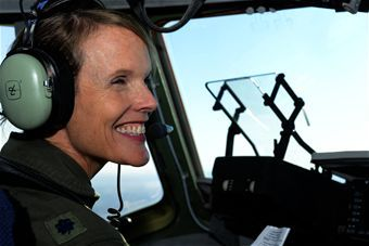 First female C-17 aviation pioneer retires - U.S. Air Force Lt. Col. Debi Rieflin, 315th Operation Support Squadron instructor pilot, smiles during her final (fini) flight in the C-17 Globemaster III conducted with an all female crew Oct. 27, 2014 at Joint Base Charleston, South Carolina. Rieflin is the first female C-17 aircraft commander with 21 years in the aircraft and retiring with 31 years in the Air Force. (U.S. Air Force photo/Senior Airman Sandra Welch)