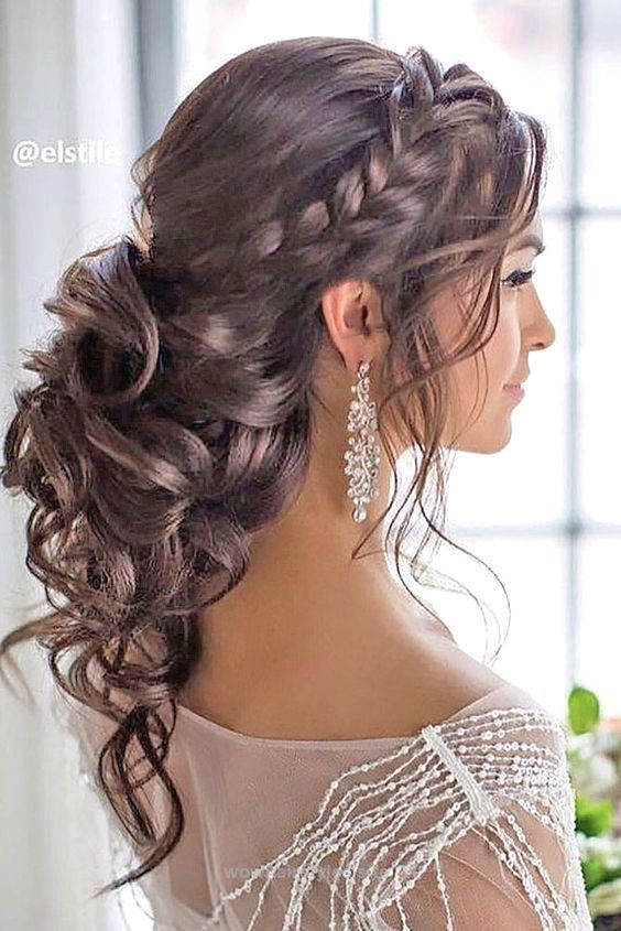 Glamorous side braided curly low updo wedding hairstyle; Featured ...