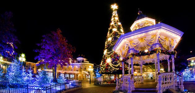 Christmas tree and decorations on main street usa disneyland indulge yourself in the magic of disneys enchanted christmas celebration at disneyland paris from mid november 2017 to early january solutioingenieria Choice Image