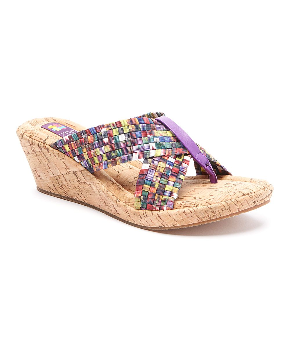 Zee Alexis by CC Resorts Mosaic Sassy Wedge Sandal   zulily -  $24.99 $95.00 size: size chart 35 36 37 38 39 40 41 42 Product Description:  Featuring a lightweight and flexible cork sole, this criss-cross woven wedge sandal easily responds to your every step.      2.25'' heel with 1'' platform     Memory foam footbed     Lightweight SoleFlex™ Technology     Active Response Technology™     Handwoven, stretch elastic upper     Man-made lining     Man-made sole     Imported
