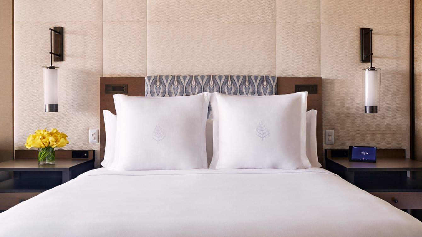 Partial Ocean View Room Bed With White Pillows With Four Seasons