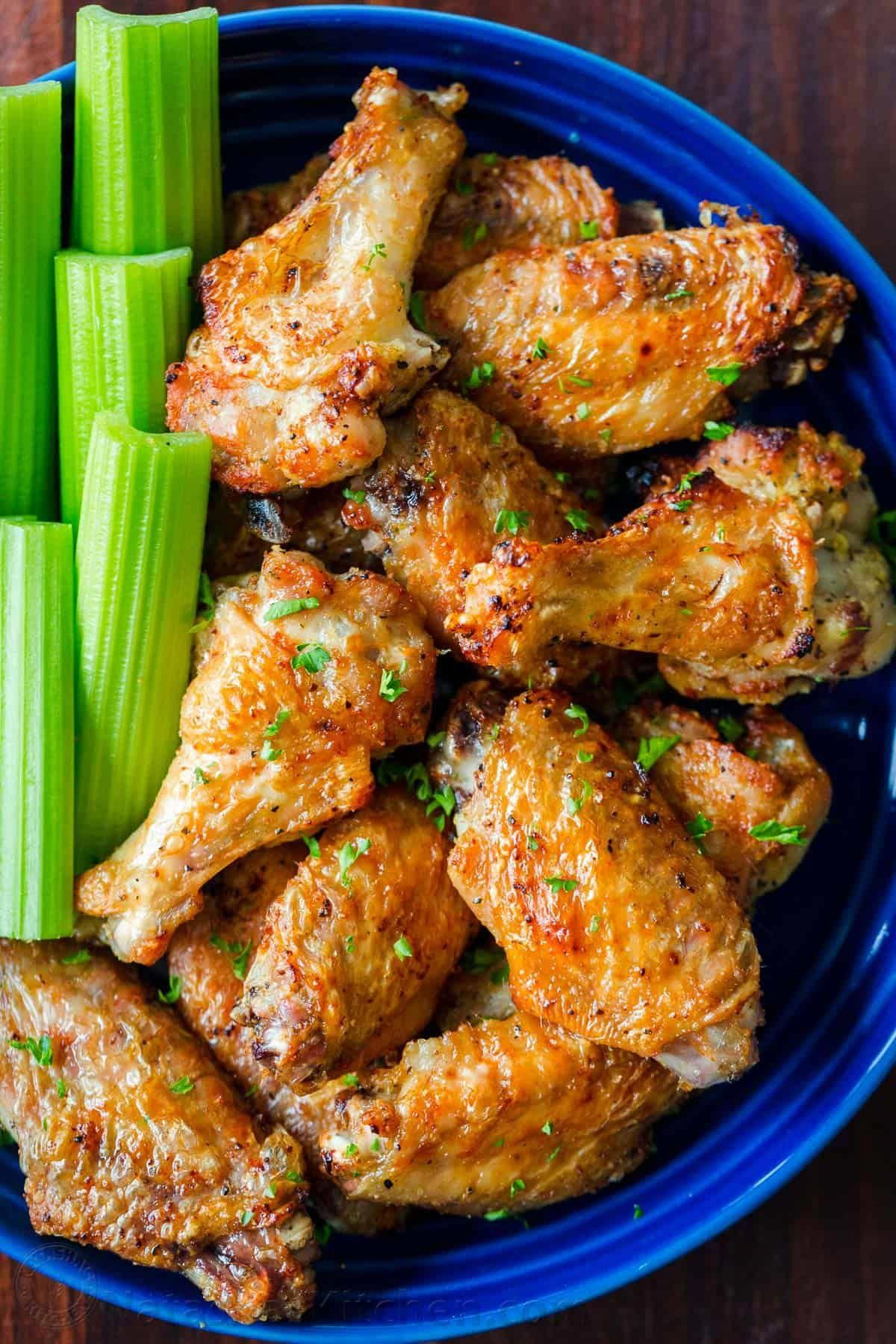 Air Fryer Chicken Wings with crisp salty skin, perfectly seasoned with garlic and lemon pepper. Air fried chicken wings cook so fast with no marinating!