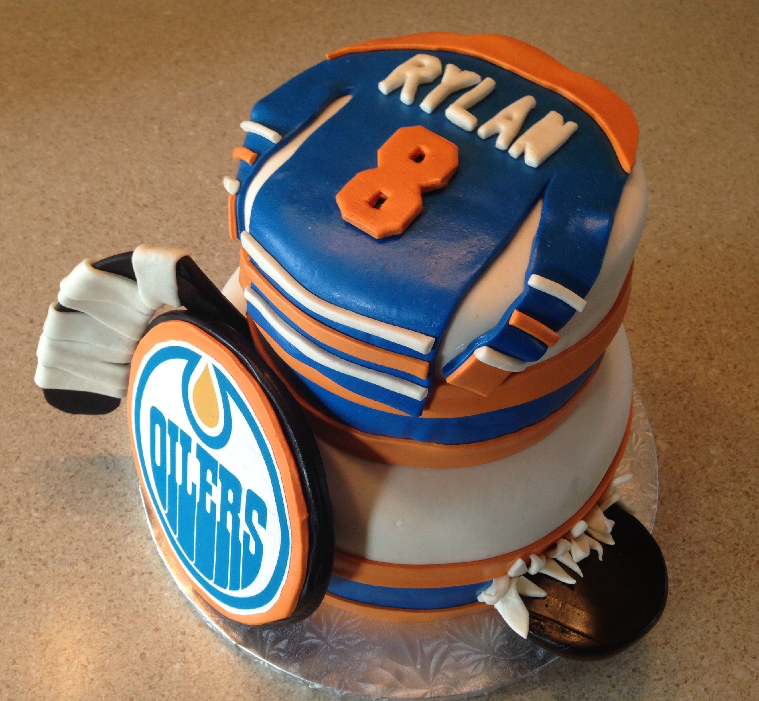 Oilers cake with jersey hockey puck and stick maxs bday