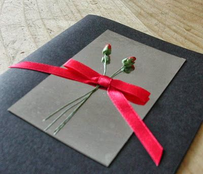 looks like an invite to a funeral, but I love the simple concept.... with lighter colors