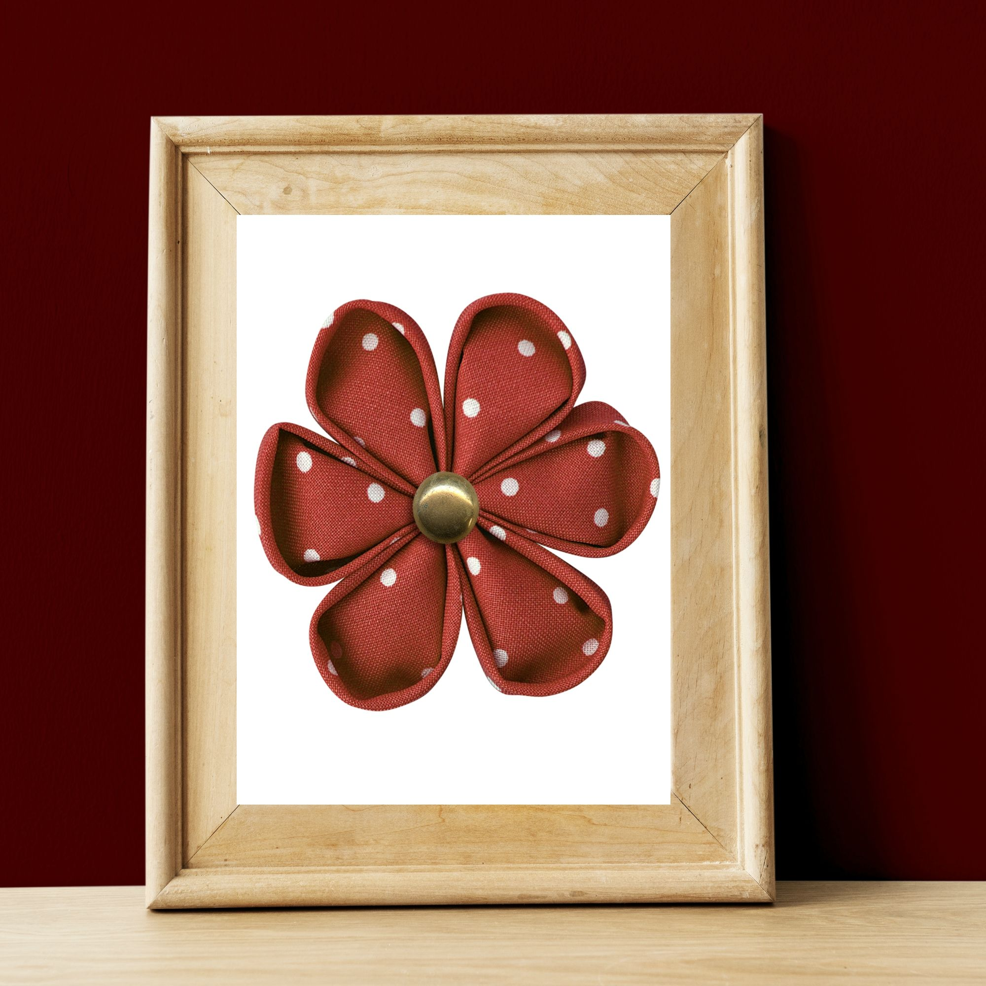 Burgundy dotted flower six petals with brass center in