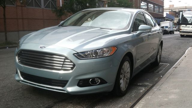 Ford Fusion Hybrid Looks Like An Aston Martin And Isn T Boring To Drive Ford Fusion Aston Martin Ford