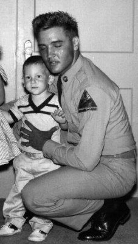 Elvis with Pickles' little brother (Eddie Fadal's son) while stationed at Fort Hood Texas.