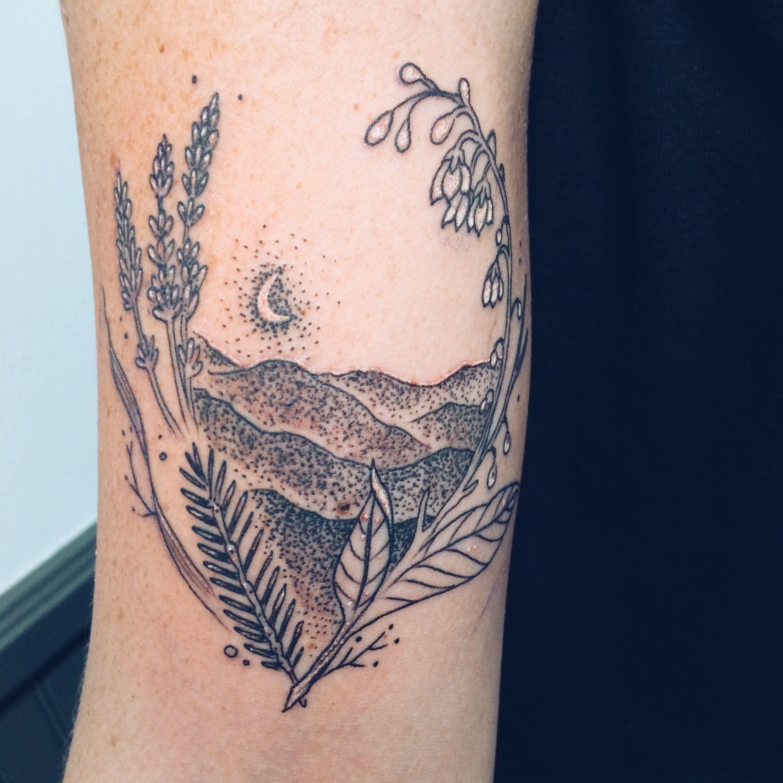 moon mountains wild flowers tattoo speakeasy tattoo