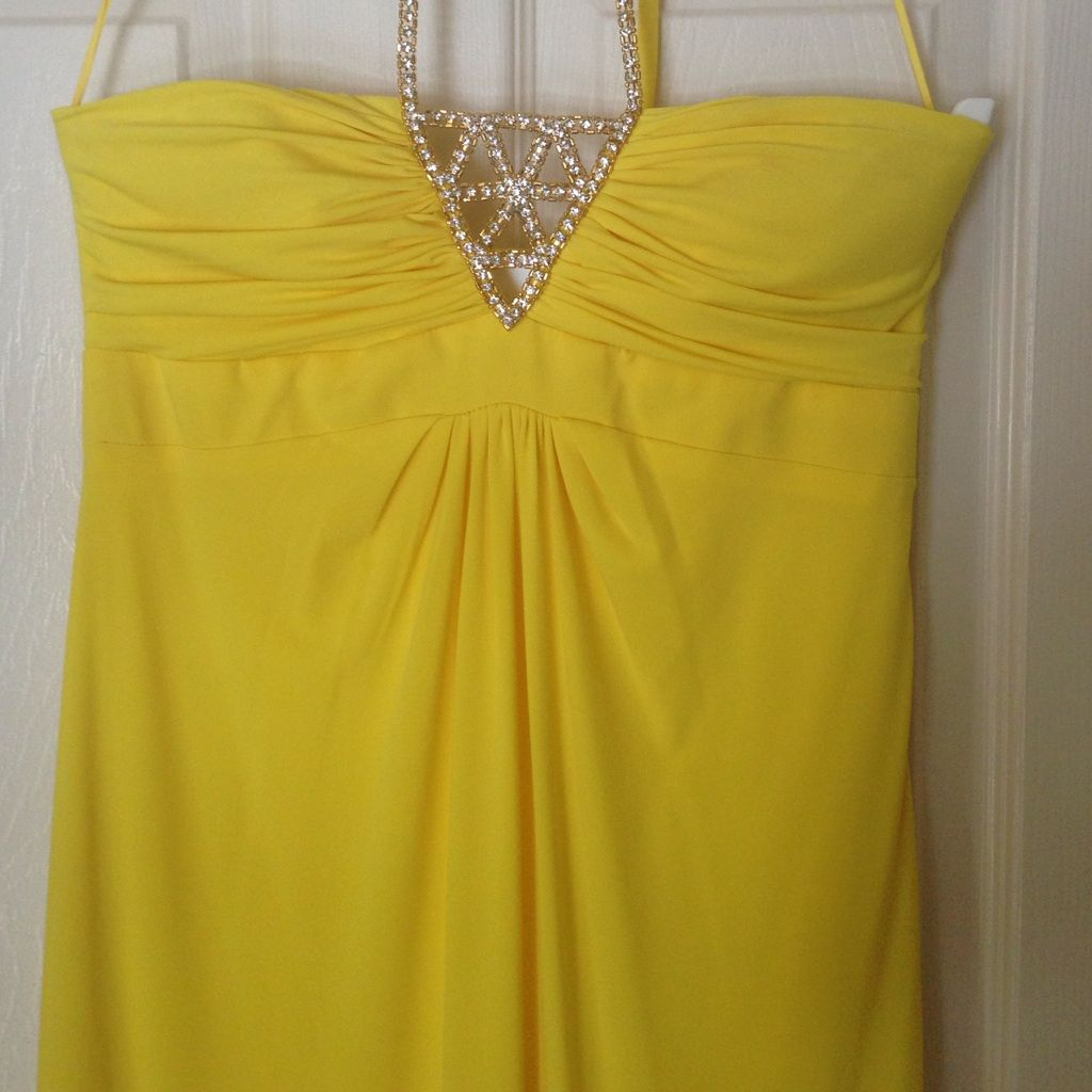 Gorgeous yellow gown with sparkly halter straps yellow gown and
