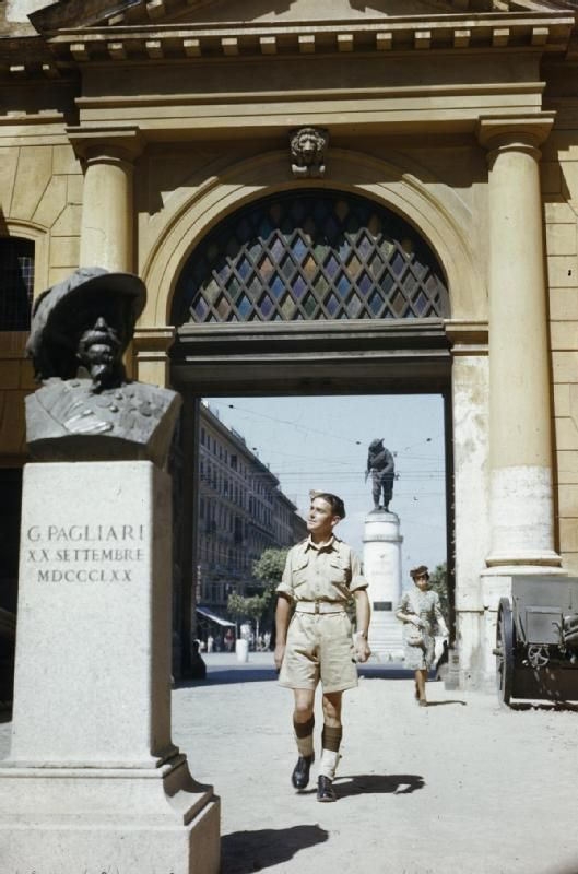'A Day in Rome with Gunner Smith': Gunner Smith walking through the Porta Pia, which has been converted into a museum of the Bersaglieri. June 1944.