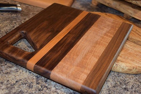 This Eye Catching Board Made With Walnut Maple And Teak Is