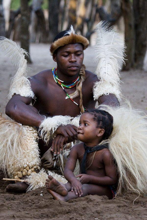 Africa | Zulu father and daugher wearing traditional dress.  Kwazulu Natal, South Africa | ©Michael Deeble
