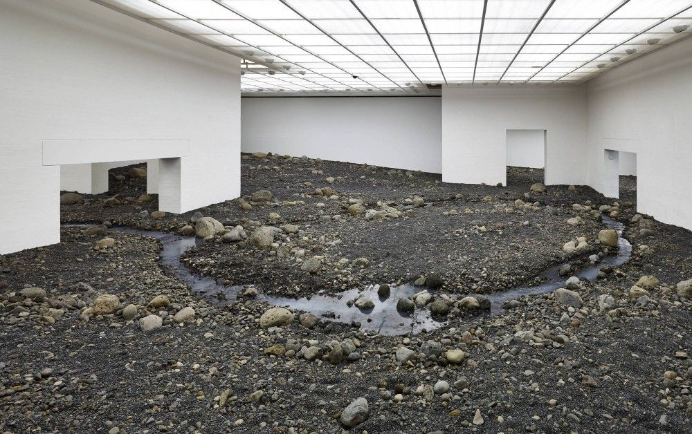 Olafur Elliasson´s riverbed stones installation - Feels like the Matrix virtual reality with white walls  //  Three Writers On Olafur Eliasson´s Riverbed
