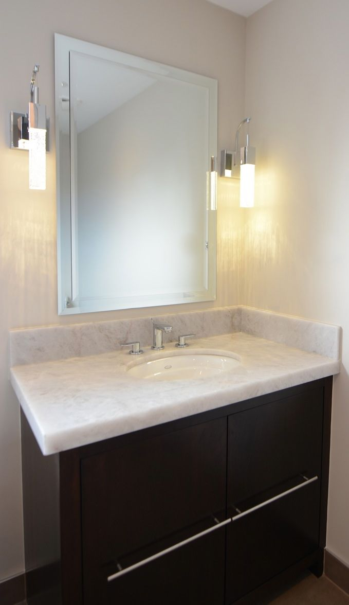 AFTER - his/hers sink vanities with onyx countertops flanking a freestanding tub