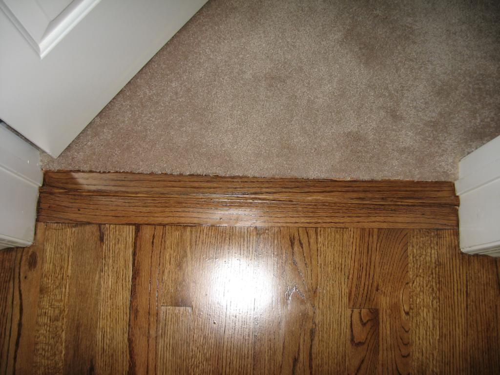 This Is A Simple Close Up View Showing The Use Of A 2 1 4 Cross Board To Create A Prefectly Straight Flush Transition Hardwood Floors Flooring Bedroom Carpet