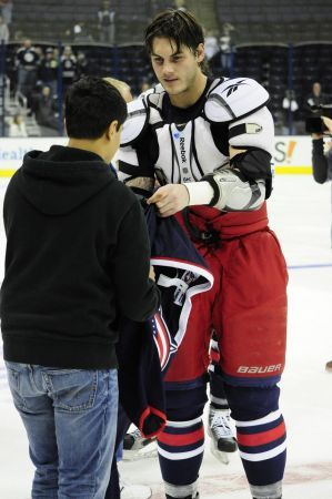 Jared Boll, Columbus Blue Jacket #40, Right Wing, giving a fan the shirt off his back after 2013 Opening Night at Nationwide Arena, Columbus, Ohio.
