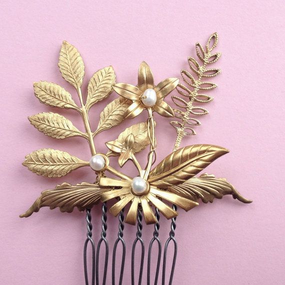 Fleur de Foret Comb by Katie Burley Millinery, $55.00  Tuck this delicate and dainty hair jewel into a bun or above your ear. Perfect for the bride, for each of your bridesmaids or wear it as a guest!  Golden brass flowers and foliage made from vintage molds, are hand pieced together and wired with fresh water pearls.